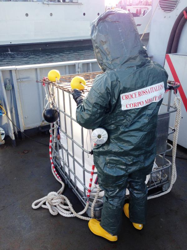 """FIG.2. """"Tremiti"""" Italian Navy Vessel, ItRC MC Operator / Protection recommended measures in biocontainment environment – Tyvek suit and PAPR - rear view."""
